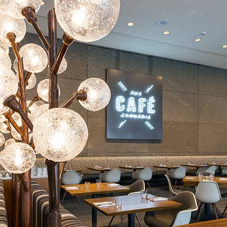 Inside the Cafe focusing on the lighted logo sign